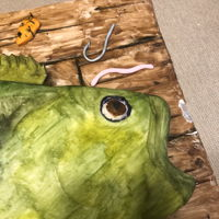 Large Mouth Bass Cake Fish is cake. Hooks, worms, lures, and board is fondant.