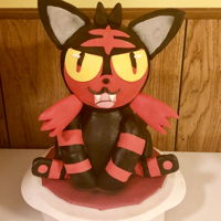 Litten Cake Litten Pokemon cake that I did for a friend. Lemon cake, lemon SMBC, chocolat rice crispy, lemon cake pop dough, dark chocolate ganache,...