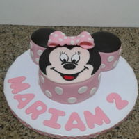 Minnie Mouse Cake 3 cakes covered in fondant, decorations also fondant