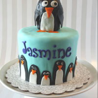 Penguin Cake Six inch round in Fondant with sculpted rice krispy treat Penguin on top.