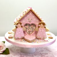 Valentine Valentine cookie house, all cookies decorated with royal icing. Fondant covered cake board, sprinkles
