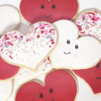Valentine Cookies Sugar cookies with royal icing, sprinkles and monograms. Cut using sugarbelle shape shifter heart.