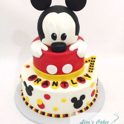 Mickey Mouse First Birthday Cake Buttercream iced cakes. Mickey's head is a styrofoam ball covered in fondant.