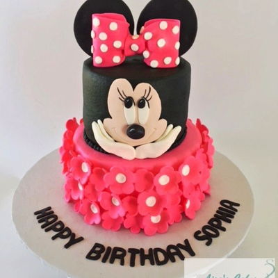 Minnie Mouse Birthday Cake Buttercream iced tiers with fondant flowers and details