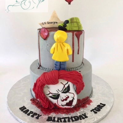 Pennywise It Cake Buttercream cake with fondant and modeling chocolate items.
