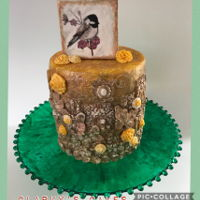 Bronze Bas Relief Anitiqued Bronze Bas relief cake with a handed painted chickadee on a gumpaste plaque.