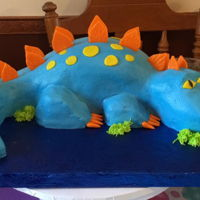 Dinosaur Cake My 5 year old Grandson can't get enough Dinosaurs! This was not easy to dowith Buttercream....but they didn't want Fondant.