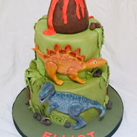 Dinosaur Cake Semi 3D fondant dinosaurs painted with gel/powder colours.