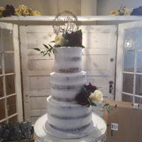 Naked Wedding Cake French vanilla cake with vanilla buttercream. Mixture of silk and real flowers for arrangements.