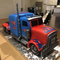 Optimus Prime Truck Cake Made with vanilla cake covered iced with chocolate ganache. Covered with homemade fondant