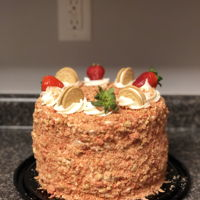 Strawberry Shortcake Cheesecake Cake 2 layers of strawberry cake with a layer of cheesecake between, the crumble outside is golden Oreos that I put in the food processor and...