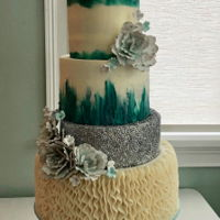 Teal Buttercream Wedding Cake I made this for a very special friend. It is all buttercream with gumpaste flowers and silver sequence.