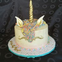 Unicorn Cake Unicorn cake for my Goddaughter 4th birthday. Cake is funfetti filled with raspberry buttercream.