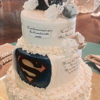 Wedding Superman Cake traditional wedding cake with all the verses and songs and in the back her superhero Superman with ruffles