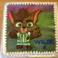 Wilde Likes Lobo At 4! Lobo from Super Monsters cartoon. Fondant base for the character is covered in candy clay detail. Cake is airbrushed.