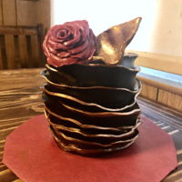 Black Ruffle Cake! Upwards ruffle cake, using modeling chocolate for the ruffles, rose, and leaf. Painted gold with a new edible paint that I am absolutely in...
