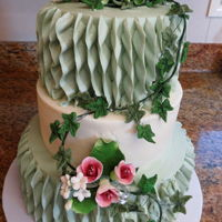 Buttercream Ruffles Buttercream covered 3 tier cake. Buttercream ruffles on the top and bottom tiers, with gumpaste flowers and ivy.
