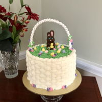Easter Basket Cake Meyer Lemon layer cake with buttercream basketweave topped with chocolate bunny and eggs