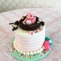 "Easter Mini Cake Three layer 6"" round vanilla cake with buttercream frosting. Fondant bird and birds nest and flowers .assorted candies and..."