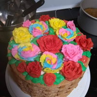 Flower Basket Cake This was one of my first few cakes. It was my first attempt at piping flowers or basketweave... I believe it was my first time piping...