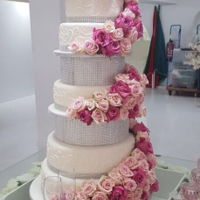 Fondant Bling Wedding Cake This was my first time using fresh roses on a cake. I really loved the outcome. The lowest 2 tiers where dummy (Styrofoam). When I...