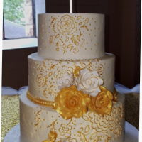Gold And White Wedding Cake Wedding cake I did in buttercream. Piped design with royal icing then over painted with gold luster dust mixed with vodka. Roses are made...