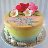 Hawaiian Cake Nine inch round in buttercream with Gumpaste flowers and White Chocolate seashells.
