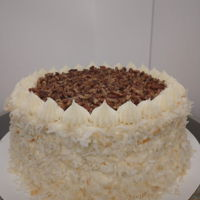 Italian Cream Cake Italian cream cake with cream cheese frosting, roasted pecans, and toasted coconut.