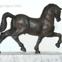 Leonardo's Horse Made of modeling chocolate with a wire armature and airbrushed to resemble bronze, Leonardo's Horse stands on a base covered in...