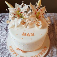 Lilies And Roses Cake. Sugar lilies and roses cake. Hope you like it. Zoe. X www.facebook.com/TheCakeNook