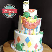Llama Cake Smooth buttercream with buttercream dot border, fondant embellishments and fondant topper.