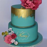 Pink Peony On Teal Made for a 70th birthday. Gumpaste flowers and accented in gold.