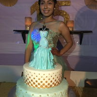 Quinceañera Birthday Cake Top cake was chocolate filled with chocolate mousse and the bottom cake was vanilla cake filled with dulce de leche and roasted walnuts....