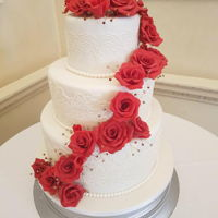 Red Rose Wedding Cake. Sugar red roses, all hand made, with none edible sparkly diamante's, finished of with edible sugar lace. www.facebook.com/TheCakeNook...