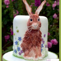 Scraggly Hare Edible hare cake in a flower meadow