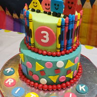 Shapes/crayons (Mr Maker) Cake Decorated 2 Tier Cake with Homemade Fondant Edible Shapes , Crayons and Letters for a special little guy who is in love with Shapes and...