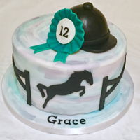 Showjumping Cake With Watercolour Effect Fondant Chocolate cake covered in fondant and painted with food colouring gel mixed with vodka. Riding hat made from rkt.