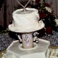 "Small Wedding Cake Made Bigger When someone wants a wedding cake to serve not much more than a dozen make it look bigger. A12""x4"" hexagon ring cake w/..."