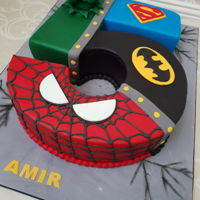 Superhero Theme Cake Superhero themed no 5 novelty cake.Inside chocolate mud cake filled with dark chocolate ganache.