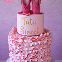 Tutu Sweet Ballerina Cake A Tutu Sweet Ballerina Cake featuring pink fondant ruffles and gumpaste ballet slippers. By Love Cake Create