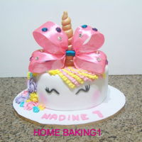 Unicorn Cake chocolate cake covered in fondant , decorated with buttercream and satin ribbon
