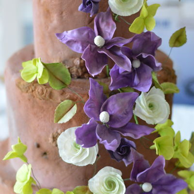 Woodland Wedding Cake With Violet Clematis And Lime Green Hydrangeas