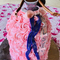 Barbie Dress Cake Five layer cake with buttercream rosettes and fondant ribbons. I'm hoping it didn't melt outside in the heat!