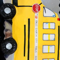 School Bus Cake Marble cake, vanilla ABC, fondant decorations, donut wheels!!!