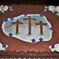 3 Crosses Cake Made for a church celebration. 12x18 yellow cake, chocolate BC with fondant elements and VBC rosettes.
