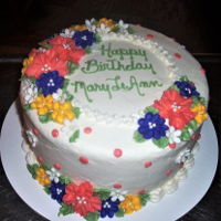 Birthday Cake-Mary Leann chocolate cake with VBC, buttercream flowers, tiny white fondant flowers.