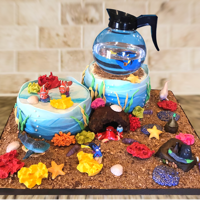 Finding Dory I made this cake for my Grand daughters 2nd birthday. One cake was a chocolate cake with a cookies-n-cream filling and a vanilla...