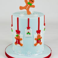Gingerbread Boy & Girl Christmas Cake Loved putting this Christmas Cake together. I love how the blue compliments the colour of the gingerbread people and works perfectly with...