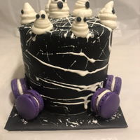 Monstrous Marshmallows Buttercream cake with marshmallow webs, ghosts, and purple macarons