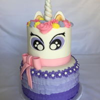 Unicorn With Purple Ruffles I made this cake for my grand-daughters 4th birthday!Chocolate cake with a cookies-n-cream filling and chocolate buttercream.White Almond...
